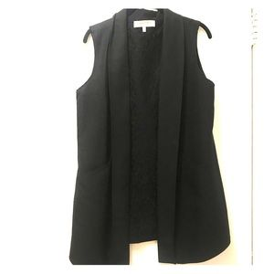 Black sleeveless vest with lace lining and pockets